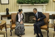 US President Barack Obama meets with Myanmar&#39;s Aung San Suu Kyi in the Oval Office. Both Nobel laureates, Obama and Suu Kyi, who wore a black blouse, black and white lunghi wrap skirt and a pink scarf, sat side-by-side, smiling, as photographers were ushered into the room before their private meeting