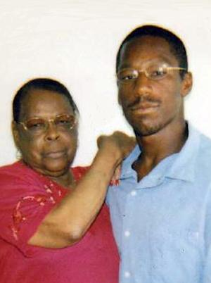 This undated image provided by Deirdre O'Connor shows John Edward Smith posing with his grandmother, Laura Neal. Prosecutors are going to court Friday Sept. 21, 2012 to seek dismissal of charges against a former gang member convicted of a drive-by murder in a gang infested neighborhood of Los Angeles 19 years ago.    (AP Photo/Deirdre O'Connor)