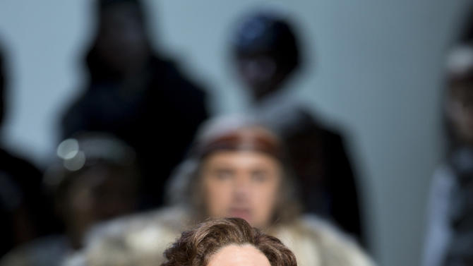 This undated handout photo provided by the Washington National Opera shows Angela Meade as Norma, foreground, and Dmitry Belosselskiy as Oroveso, background. (AP Photo/Scott Suchman, WNO)