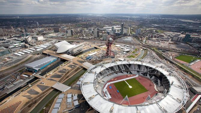 """FILE This Monday April 16, 2012 file photo provided by LOCOG shows an aerial view of the Olympic Park showing the London 2012 Olympic Stadium, foreground and the Aquatics Center, white building at left.  London will be the social media Olympics. For all the history and tradition associated with London, a very modern-day phenomemon will play a prominent role at the upcoming Summer Games. Tweet this: These will be the first Olympics told in 140 characters or less. The London Games will be the most tweeted, micro-blogged, liked and tagged in history, with fans offered a never before seen insider's view of what many are calling the social media Olympics, or the """"socialympics."""" (AP Photo/Anthony Charlton/LOCOG)"""