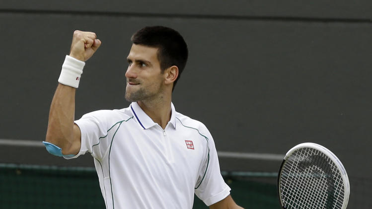 Novak Djokovic of Serbia reacts during a quarterfinals match against Florian Mayer of Germany at the All England Lawn Tennis Championships at Wimbledon, England, Wednesday, July 4, 2012. (AP Photo/Kirsty Wigglesworth)