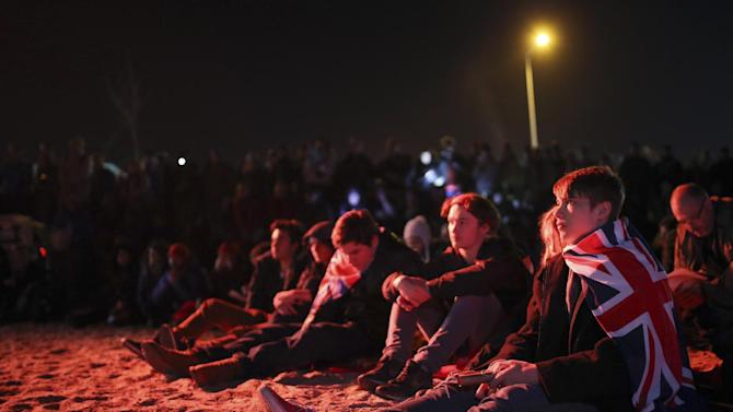 "People gather on the beach in Hamza Bay, at the Gallipoli peninsula, Turkey, early Saturday, April 25, 2015. Hundreds of people gathered on a beach in what they called ""alternative"" Dawn Service ceremony. The invitation-only official ceremony was held at the Anzac Cove commemorative site, a small cove on the Gallipoli peninsula and the site of World War I landing of the ANZACs (Australian and New Zealand Army Corps) on April, 25, 1915. As dawn broke, families of soldiers, leaders and visitors gathered near former battlefields, honoring thousands of Australians and New Zealanders who fought in the Gallipoli campaign of World War I on the 100th anniversary of the ill-fated British-led invasion. (AP Photo/Emrah Gurel)"