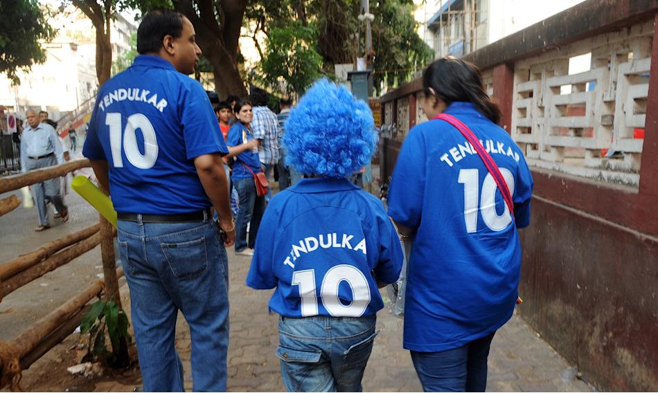 An Indian family wearing t-shirts of Mum