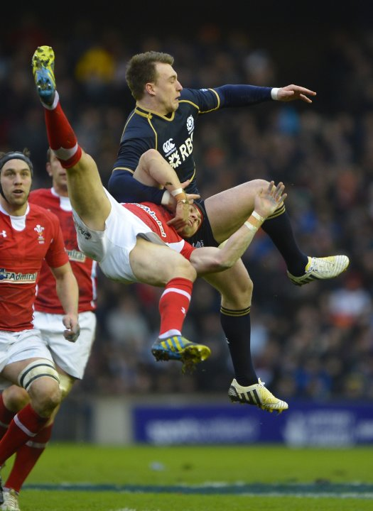 Scotland's Hogg challenges Wales' Halfpenny to a high ball during their six nations rugby union match in Edinburgh