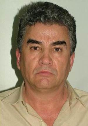 """In this photo released by the Spanish Interior Ministry on Friday Aug. 10, 2012,  a suspected member of a Mexican drug cartel, Jesus Gutierrez Guzman is seen in this hand out photo. The Interior Ministry said Friday Aug. 10, 2012, Spanish police working in a joint investigation with the FBI's Boston Division have halted an attempt by a major Mexican drug smuggling ring to establish a European operation.  Four alleged members of the Sinaloa cartel, including Jesus Gutierrez Guzman, a cousin of """"the biggest drug trafficker in the world,"""" Joaquín Archivaldo Guzman Loera known as """"El Chapo"""" have been arrested in Madrid a statement says. The statement Friday said Spain was to have been used by the cartel as a gateway for drug importation and distribution throughout Europe but investigators intercepted a container carrying 373 kilos (822 pounds) of cocaine in July, leading to the arrests. (AP Photo/ Spanish Interior Ministry)"""