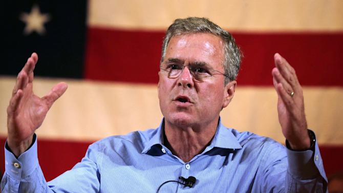 FILE - In this July 23, 2015 file photo, Republican presidential candidate former Florida Gov. Jeb Bush addresses guests during a town hall style gathering in Gorham, N.H.  Bush and four other GOP presidential candidates are at a luxury Southern California resort speaking to the billionaire Koch brothers and other conservative donors. (AP Photo/Charles Krupa, File)
