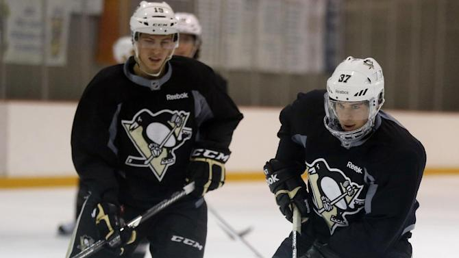 Pittsburgh Penguins Sidney Crosby, right, skates with James Neal during an NHL hockey practice on Friday, April 26, 2013, in Canonsburg, Pa. (AP Photo/Keith Srakocic)