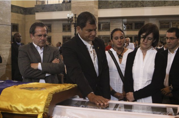 Handout of Ecuador's President Correa viewing Chavez's coffin during a wake at the military academy in Caracas