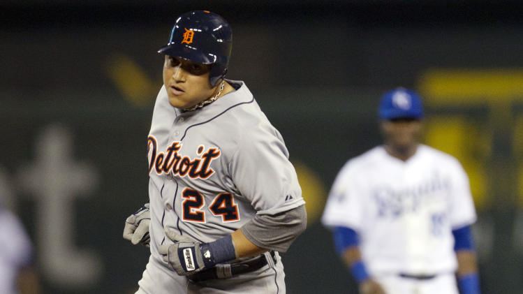 Detroit Tigers' Miguel Cabrera (24) rounds the bases after hitting a solo home run during the sixth inning of a baseball game against the Kansas City Royals at Kauffman Stadium in Kansas City, Mo., Monday, Oct. 1, 2012. (AP Photo/Orlin Wagner)