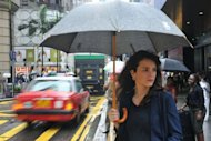 French expatriate Annie Pudlo stands on a street in Hong Kong&#39;s Central district. The French are increasingly attracted to East Asia countries to thrive on Asian growth, which contrasts with the grey European economic outlook