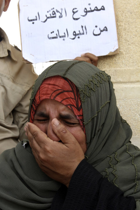 The mother of Egyptian border policeman Ahmed Abd el-Fadia, who was kidnapped last Thursday in northern Sinai, protests at the Rafah, Sinai, border crossing between Egypt and the Gaza strip, Sunday, M