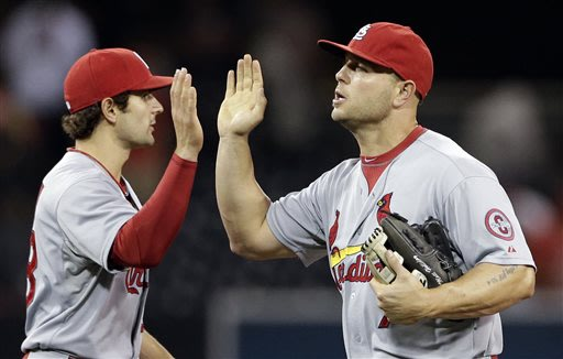 St. Louis Cardinals left fielder Matt Holliday, right, celebrates with teammate shortstop Pete Kozma after beating the San Diego Padres 5-3 in their baseball game Wednesday, May 22, 2013, in San Diego