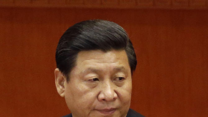 Chinese Vice President Xi Jinping attends during the closing ceremony for the 18th Communist Party Congress at the Great Hall of the People in Beijing, China, Wednesday, Nov. 14, 2012. Designated as successor five years ago, Xi will take over as party general secretary from Hu Jintao on Thursday, Nov. 15 and as president next spring, in only China's second orderly transfer of power. (AP Photo/Lee Jin-man)