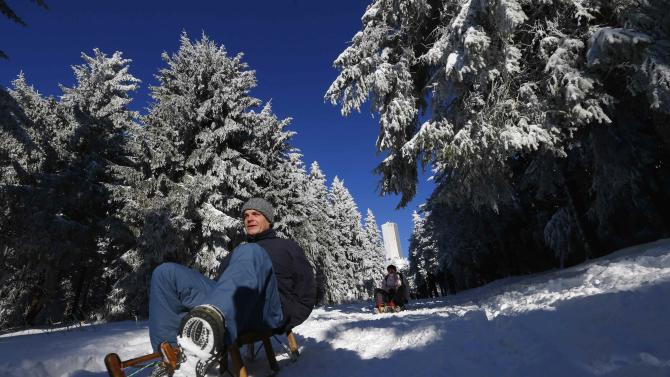 A sleigher enjoys the freshly fallen snow at the Feldberg mountain, north-west of Frankfurt