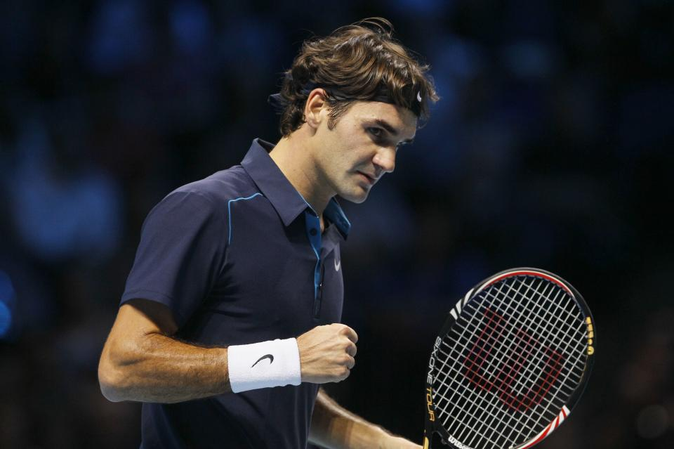 Roger Federer of Switzerland celebrates winning a point during the round robin singles tennis match against Rafael Nadal of Spain at the ATP World Tour Finals at O2 Arena in London, Tuesday, Nov. 22, 2011.  (AP Photo/Kirsty Wigglesworth)
