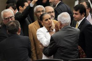 "Former Senator Silva is consoled by other lawmakers after Supreme Electoral Tribunal made decision not to grant her request to register new political party named ""Rede Sustentabilidade"" in Brasilia"