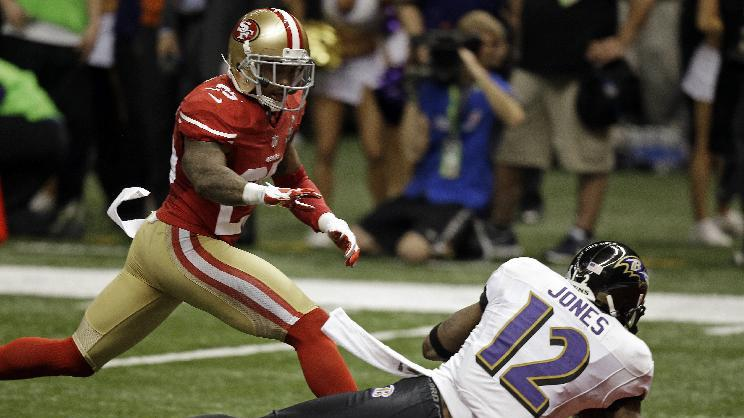 Baltimore Ravens wide receiver Jacoby Jones (12) catches a 56-yard touchdown pass against San Francisco 49ers cornerback Tarell Brown (25) during the first half of the NFL the Super Bowl XLVII football game, Sunday, Feb. 3, 2013, in New Orleans. (AP Photo/Gene Puskar)