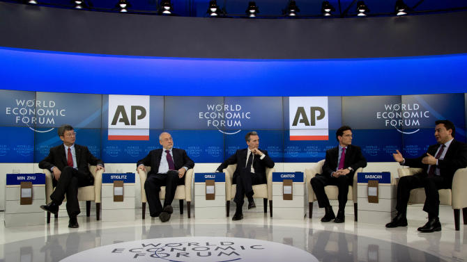 Chinese Min Zhu, Deputy Managing Director of the International Monetary Fund, American professor Joseph E. Stiglitz, Vittorio Grilli, Italian Minister for Economy and Finance, U.S congressman Eric Cantor and Ali Babacan,Turkey's Deputy Prime Minister for Economic and Financial Affairs, from left to right, participate in the Associated Press session 'Creating Economic Dynamism' during the  the 43rd Annual Meeting of the World Economic Forum, WEF, in Davos, Switzerland, Friday, Jan. 25, 2013.  (AP Photo/Anja Niedringhaus)