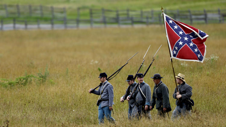 Re-enactors cross the field of Pickett's Charge ahead of a commemorative march at Gettysburg National Military Park during ongoing activities commemorating the 150th anniversary of the Battle of Gettysburg, Wednesday, July 3, 2013, in Gettysburg, Pa. Union forces turned away a Confederate advance in the pivotal battle of the Civil War fought July 1-3, 1863, which was also the war's bloodiest conflict with more than 51,000 casualties. (AP Photo/Matt Rourke)