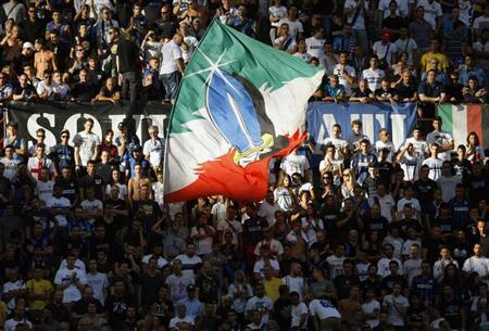 Inter Milan's supporters wave a flag during their Italian Serie A soccer match against Genoa at the San Siro stadium in Milan August 25, 2013. REUTERS/Alessandro Garofalo