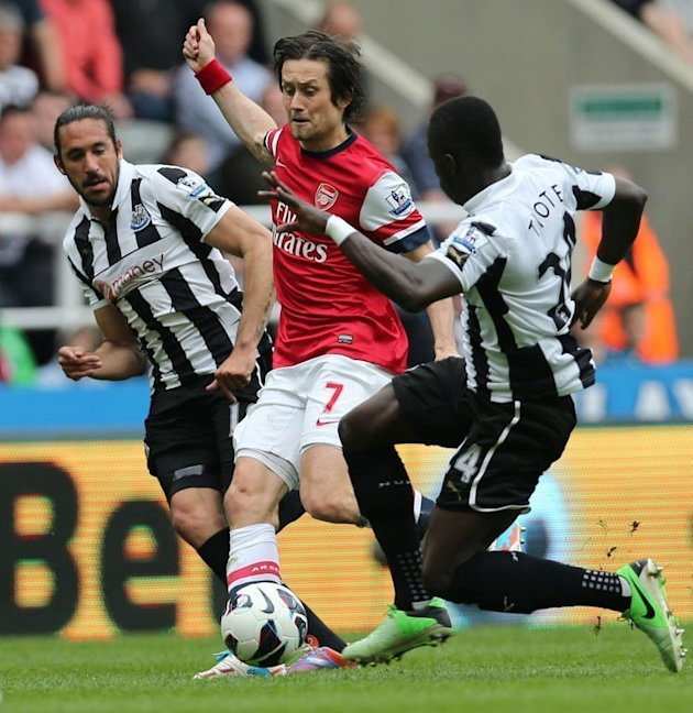 Tomas Rosicky (C) fights for the ball with Newcastle's Cheick Tiote (R) and Jonas Gutierrez on May 19, 2013