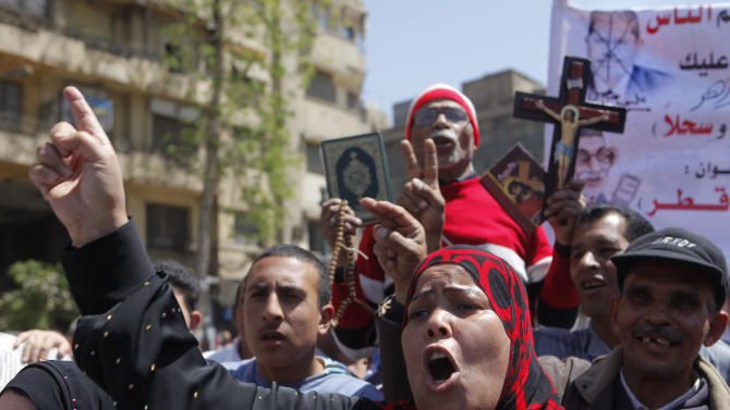 An Egyptian woman shouts anti-Muslim Brotherhood slogans during a protest in Tahrir Square, the focal point of Egyptian uprising, to support judicial independence in Cairo, Egypt, Friday, April 26, 2013. Egypt's Islamist-led parliament on Wednesday pushed ahead with a law that could force into retirement many of the nation's most senior judges, despite an uproar by the judiciary over fears the president's allies want to control the courts.(AP Photo/Amr Nabil)