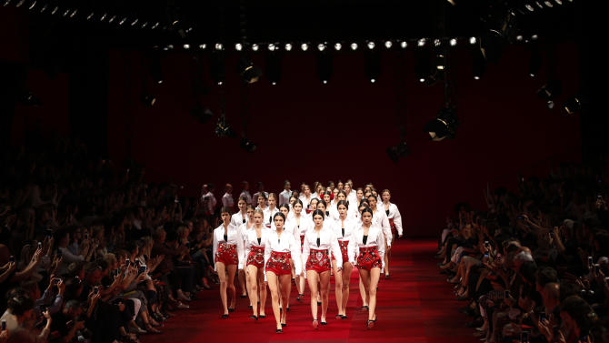 Models wear creations for Dolce&Gabbana women's spring-summer 2015 collection, part of the Milan Fashion Week, unveiled in Milan, Italy, Sunday, Sept. 21, 2014. (AP Photo/Luca Bruno)