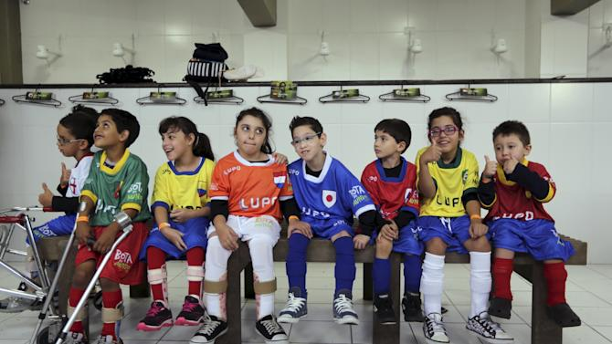 """Disabled children prepare to attend a """"World Boots"""" soccer event for children with disabilities, at the Neymar Institute in Praia Grande"""