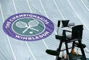 The rain covers protect a court at the Wimbledon Tennis Championships, in London