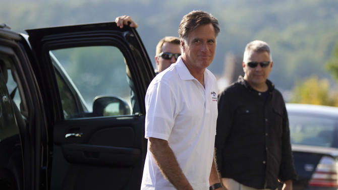Republican presidential candidate Mitt Romney arrives at Brewster Academy for convention preparations on Sunday, Aug. 26, 2012 in Wolfeboro, N.H.  (AP Photo/Evan Vucci)