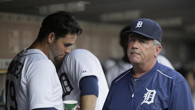 Detroit Tigers pitcher Anibal Sanchez talks with pitching coach Jeff Jones, right, after pitching the first inning of a baseball game against the Toronto Blue Jays Friday, July 3, 2015, in Detroit. (AP Photo/Duane Burleson)