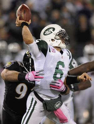 New York Jets quarterback Mark Sanchez (6) is sacked by Baltimore Ravens defensive end Haloti Ngata during the first half of an NFL football game in Baltimore, Sunday, Oct. 2, 2011. (AP Photo/Nick Wass)