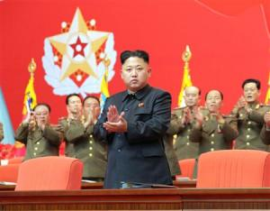 North Korean leader Kim Jong Un applauds during the second meeting of security personnel of the Korean People's Army at April 25 House of Culture