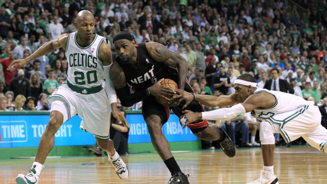 Miami Heat forward LeBron James (6) tries to drive between Boston Celtics guards Ray Allen (20) and Rajon Rondo, right, during the fourth quarter of Game 3 in the NBA basketball Eastern Conference finals, in Boston on Friday, June 1, 2012. Boston won 101-91. (AP Photo/Elise Amendola)