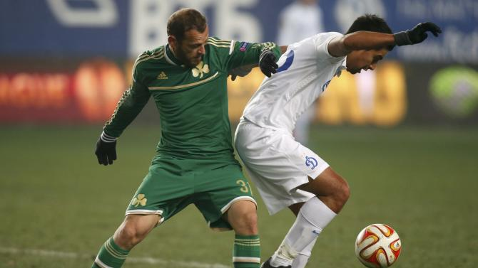 Dinamo Moscow's Christian Noboa fights for the ball with Panathinaikos' Christos Bourbos during their Europa League soccer match at the Arena Khimki stadium outside Moscow