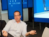 "David Schwartz, Oblong Industries vice president for sales, speaks at the Washington offices of the Los Angeles-based software company in June 2012. The software behind the film ""Minority Report"" -- where Tom Cruise speeds through video on a large screen using only hand gestures -- is making its way into the real world"
