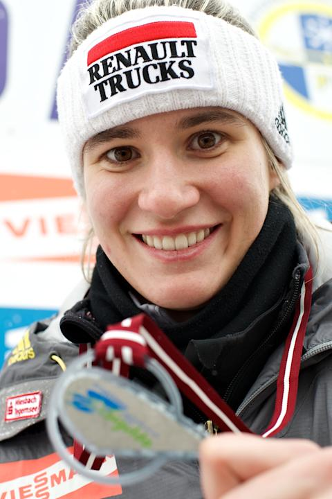 First place winner Natalie Geisenberger of Germany poses duringt the podium ceremony at the end of the women's Luge World Cup competition in Latvia's town of Sigulda, on February 19, 2012. AFP PHOTO /