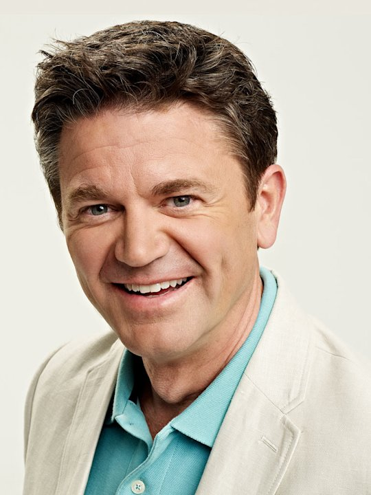 "John Michael Higgins stars as Peter Lovett in ""Happily Divorced."""