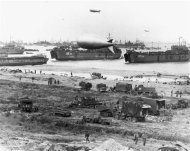 LSTs (Landing Ship Tanks), landing vehicles and cargo assemble on a Normandy beach in this June 1944 handout photo obtained by Reuters June 1, 2012. REUTERS/U.S. National Archives/Handout