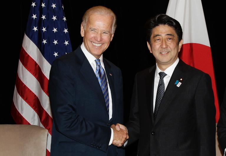 In this file photo, US Vice President Joe Biden (L) shakes hands with Japan's Prime Minister Shinzo Abe, during their bilateral meeting in Singapore, on July 26, 2013