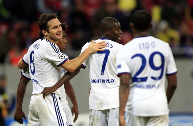 Chelsea's Lampard celebrates his goal against Steaua Bucharest with team mates during their Champions League Group E soccer match at National Arena in Bucharest