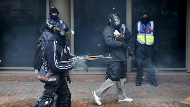 Firearms instructors play the role of militants during a police exercise in London