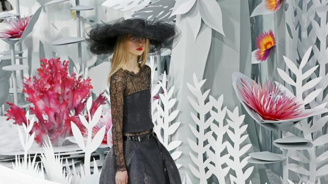 A model presents a creation by German designer Karl Lagerfeld as part of his Haute Couture Spring Summer 2015 fashion show for French fashion house Chanel in Paris