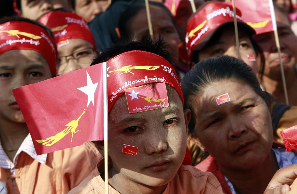 Supporters listen to a speech delivered by Myanmar pro-democracy leader Aung San Suu Kyi during her election campaign in Utarathiri township in Naypyitaw, Tuesday, March. 6, 2012. (AP Photo/Khin Maung Win)