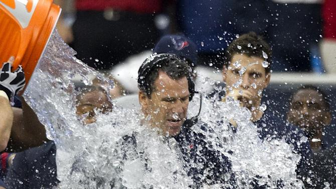 Houston Texans coach Gary Kubiak is doused during the fourth quarter of an NFL football game against the Indianapolis Colts, Sunday, Dec. 16, 2012, in Houston. The Texans defeated the Colts 29-17. (AP Photo/Houston Chronicle, Brett Coomer)  MANDATORY CREDIT