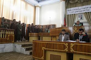 Defendants attend their trial at the Primary Court…