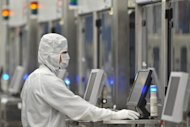 An employee of Renesas Electronics works at the company's Naka wafer fabrication factory in Hitachinaka, 2011. Japanese microchip maker Renesas Electronics will cut 6,000 jobs, or 15 percent of its workforce, a leading daily reported, as the nation's chip industry struggles on the world stage