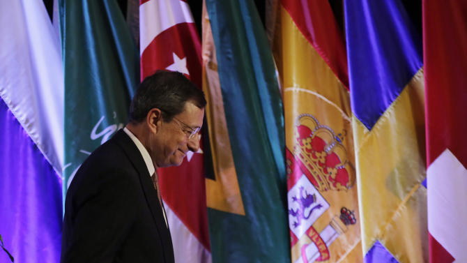 European Central Bank President Mario Draghi walks past the flags as he leaves from the venue of the International Monetary Conference in Shanghai, China, Monday, June 3, 2013. (AP Photo/Eugene Hoshiko)