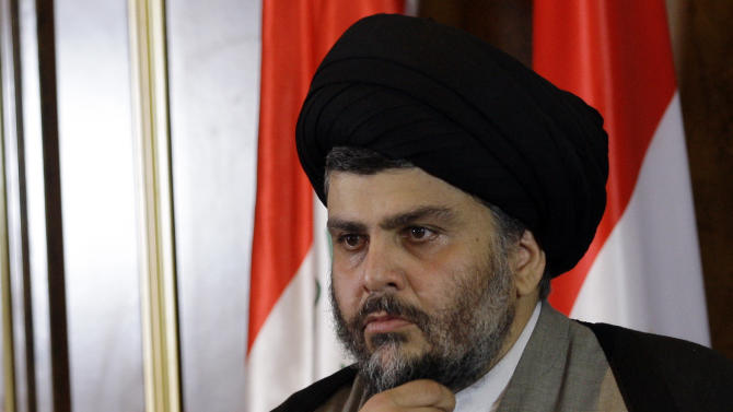 Shiite cleric Muqtada al-Sadr looks on during a press conference in Irbil, a city in the Kurdish controlled north 217 miles (350 kilometers) north of Baghdad, Iraq, Thursday, April 26, 2012. A hardline Shiite cleric is meeting with the president of Iraq's Kurdish region to try to end a political crisis that has deadlocked the nation's government. Anti-American cleric Muqtada al-Sadr offered plans Thursday to resolve the impasse through political inclusiveness.(AP Photo/Khalid Mohammed)