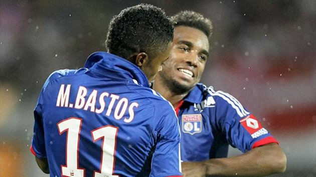 Olympique Lyon's Michel Bastos celebrates with teammate Alexandre Lacazette (R) after scoring against Evian-Thonon-Gaillard (Reuters)
